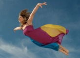 woman-flying-through-sky-side-view-1761303