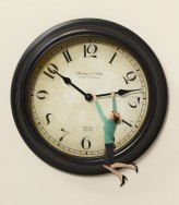 55090611e4ef2-0112-woman-hanging-on-clock-xl