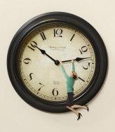 55090611e4ef2-0112-woman-hanging-on-clock-xl